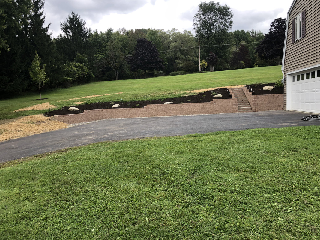 Landscape Retaining wall and steps with fresh landscaping